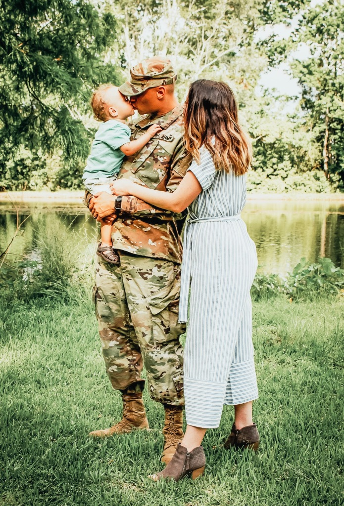 Picture of a Military Family Holding Each Other by Sarah Mozingo