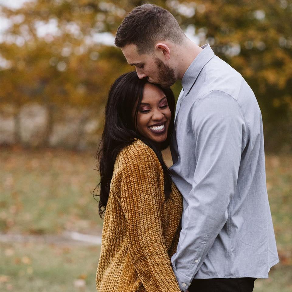 Katrina Littlepage smiling with husband