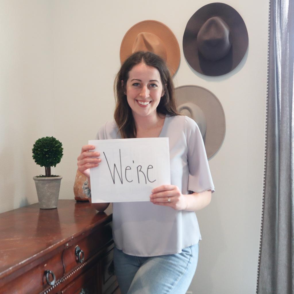 Sarah Mozingo holding a sign